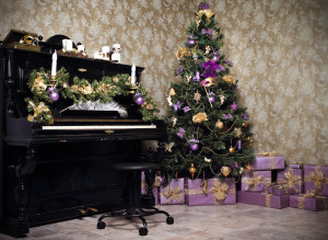 Vintage room with black piano, Christmas tree, candles, gifts  or presents and decoration