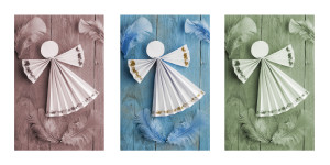 Handmade Christmas decorations,paper angel on wooden background. Triptych